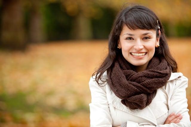Autumn woman portrait smiling outdoors at the park