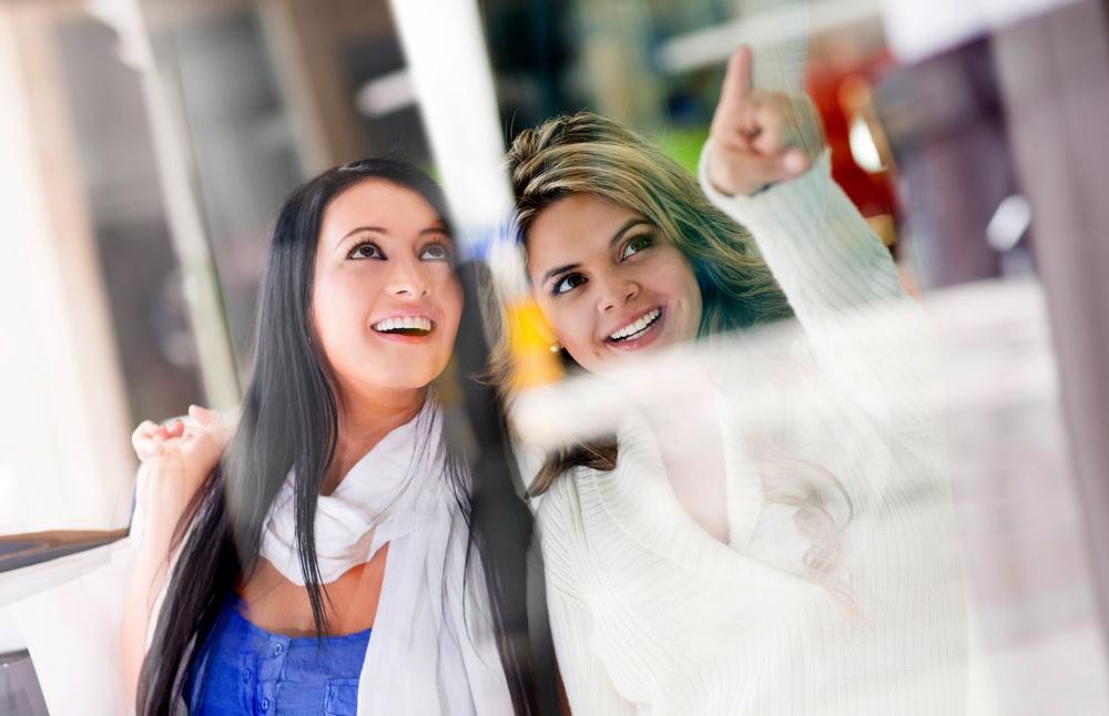Beautiful friends window shopping at the mall