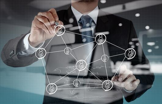 Double exposure of businessman working with new modern computer show social network structure