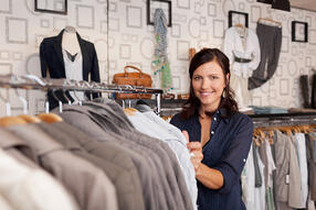 Portrait of happy female customer choosing shirt in clothing store-2