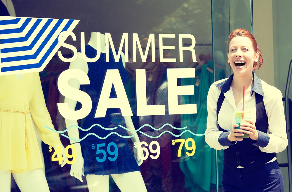Shopping time sale event. Beautiful young woman standing outside in front of store display window, summer price reduction sign excited laughing. Positive human emotion face expression. Summer spree-2