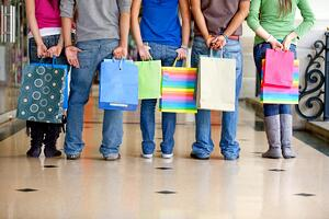 Unrecognizable group of people with shopping bags
