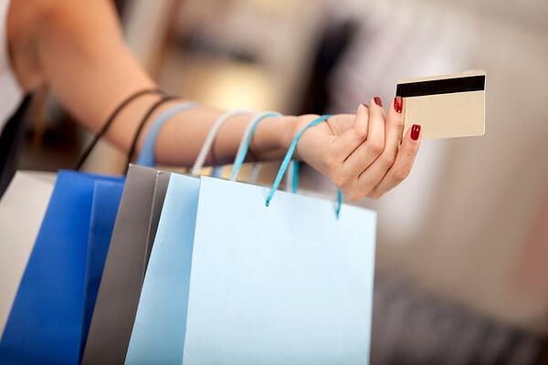 Woman shopping and paying with a debit or credit card-1