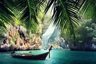 long boat and rocks on beach in Krabi, Thailand.jpeg