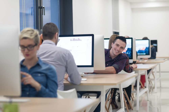 startup business, software developer working on desktop  computer at modern office-1.jpeg