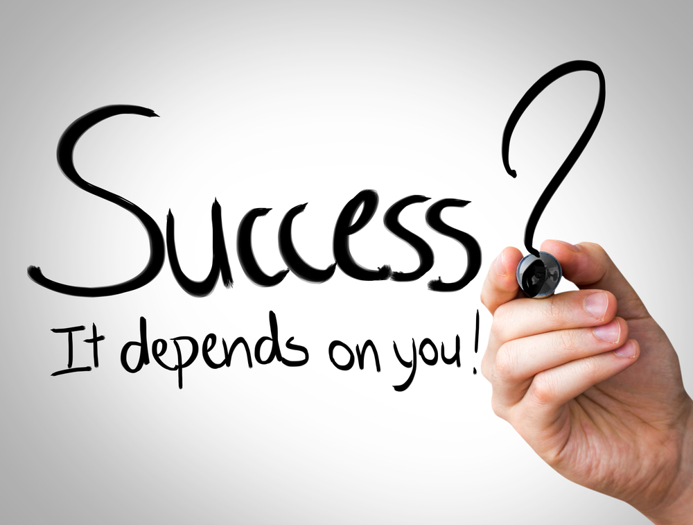 """""""Success, it depends on you"""" Hand writing with black marker on transparent wipe board"""