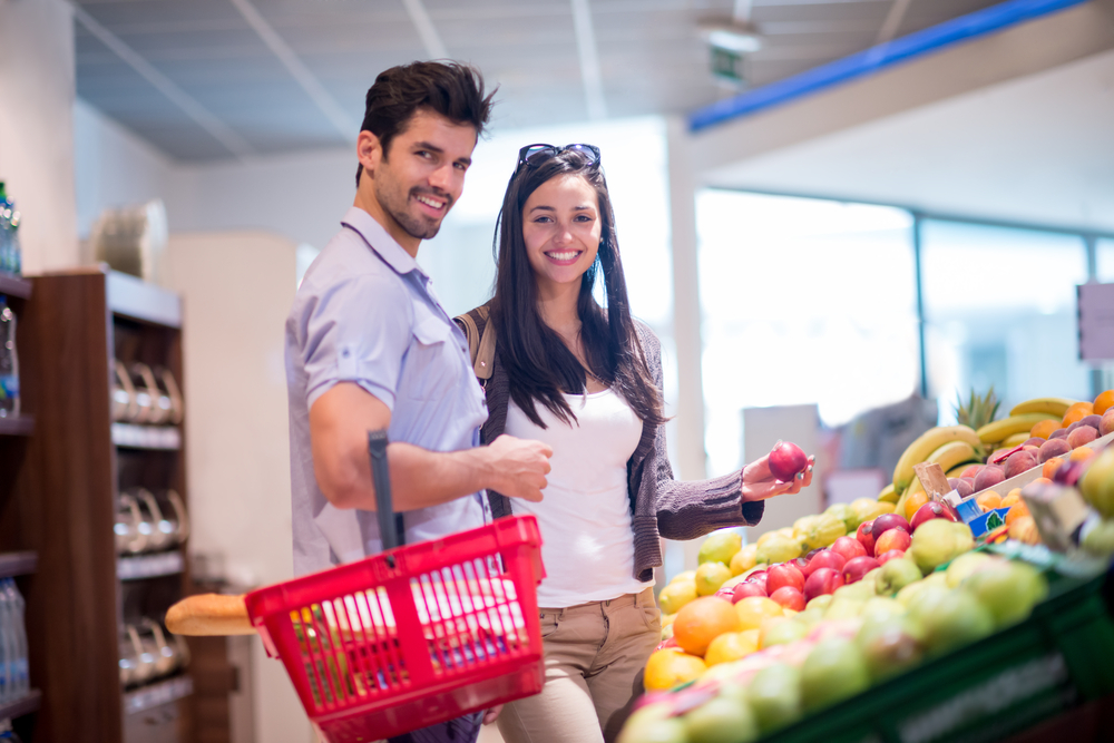 Young couple shopping in a supermarket-2